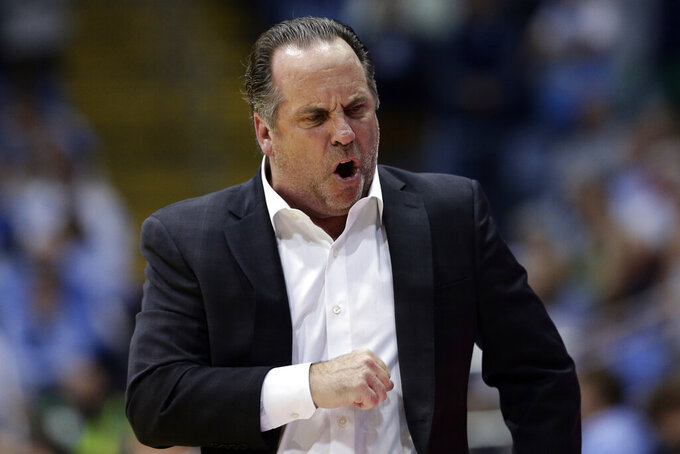 Notre Dame head coach Mike Brey reacts during the second half of an NCAA college basketball game against the North Carolina in Chapel Hill, N.C., Wednesday, Nov. 6, 2019. North Carolina won 76-65. (AP Photo/Gerry Broome)