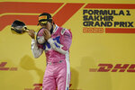 Racing Point driver Sergio Perez of Mexico celebrates wining the Formula One Bahrain Grand Prix in Sakhir, Bahrain, Sunday, Dec. 6, 2020. (Brynn Lennon, Pool via AP)