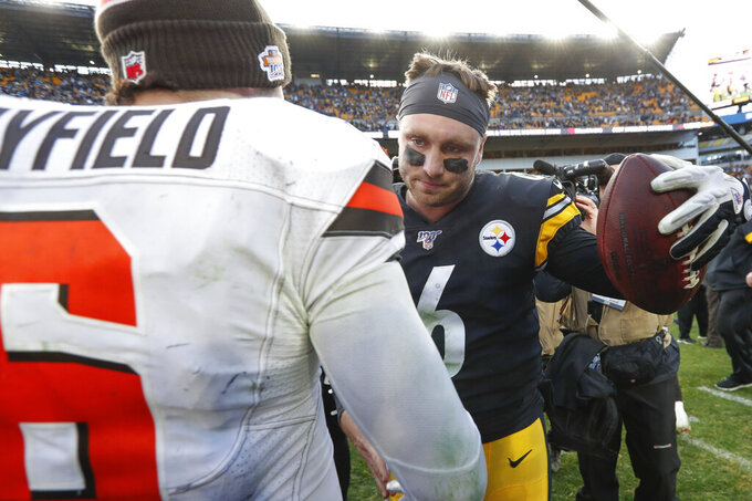 Pittsburgh Steelers quarterback Devlin Hodges, right, embraces Cleveland Browns quarterback Baker Mayfield, left, after an NFL football game, Sunday, Dec. 1, 2019, in Pittsburgh. (AP Photo/Don Wright)