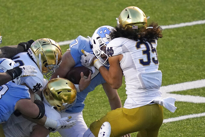 Notre Dame linebacker Marist Liufau (35) sacks North Carolina quarterback Sam Howell (7) during the first half of an NCAA college football game in Chapel Hill, N.C., Friday, Nov. 27, 2020. (AP Photo/Gerry Broome)
