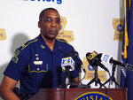 FILE - In this Friday, May 21, 2021 file photo, Col. Lamar Davis, superintendent of the Louisiana State Police, speaks about the agency's release of video involving the death of Ronald Greene, at a press conference in Baton Rouge, La. Greene was jolted with stun guns, put in a chokehold and beaten by troopers, and his death is now the subject of a federal civil rights investigation. (AP Photo/Melinda Deslatte)