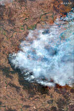 This satellite image provided by Maxar Technologies shows smoke from wildfires burning near Nabiac in New South Wales, Australia, Thursday, Nov. 14, 2019. About 60 fires were burning around New South Wales on Thursday morning, with 27 uncontained while being battled by more than 1,000 firefighters, the Rural Fire Service said. (Satellite image ©2019 Maxar Technologies via AP)