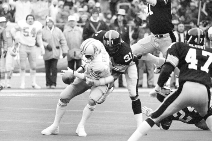 FILE - In this Jan. 6, 1980, file photo, Pittsburgh Steelers Donnie Shell (31) hits Houston Oilers' Mike Renfro causing Renfro to fumble the ball in second quarter of AFC championship NFL football game in Pittsburgh. NFL champion players Roger Craig, Drew Pearson and Donnie Shell are among the finalists for the Pro Football Hall of Fame's special centennial class announced Thursday, Dec. 19, 2019. A 25-member panel of pro football experts is charged with selecting 10 senior players, two coaches and three contributors who will be inducted into the Canton, Ohio shrine next year as part of the league's celebration of its 100th season.  (AP Photo/File)