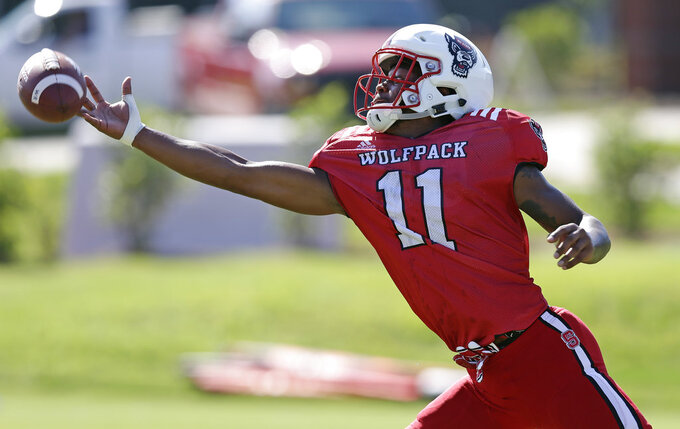 In this photo taken Thursday, Aug. 9, 2018, North Carolina State wide receiver Jacobi Meyers (11) reaches for a pass during an NCAA college football practice in Raleigh, N.C. (AP Photo/Gerry Broome)