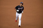 Washington Nationals' Yan Gomes rounds the bases after hitting a home run during the second inning of a baseball game against the Miami Marlins, Friday, Aug. 21, 2020, in Washington. (AP Photo/Nick Wass)