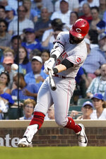 Cincinnati Reds' Jesse Winker swings on an RBI double off Chicago Cubs starting pitcher Zach Davies during the third inning of a baseball game Wednesday, July 28, 2021, in Chicago. (AP Photo/Charles Rex Arbogast)