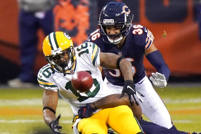 Green Bay Packers' Tavon Austin fumbles in front of Chicago Bears' DeAndre Houston-Carson during the first half of an NFL football game Sunday, Jan. 3, 2021, in Chicago. The Bears recovered the fumble. (AP Photo/Nam Y. Huh)