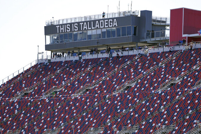 The stands on the backstretch are empty during the NASCAR Truck series auto race at Talladega Superspeedway, Saturday, Oct. 3, 2020, in Talladega, Ala.. (AP Photo/John Bazemore)