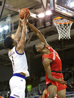 East Carolina's Jayden Gardner, left, and Houston's Chris Harris Jr., right, battle for a rebound during the first half of an NCAA college basketball game in Greenville, N.C., Wednesday, Feb. 27, 2019. (AP Photo/Ben McKeown)