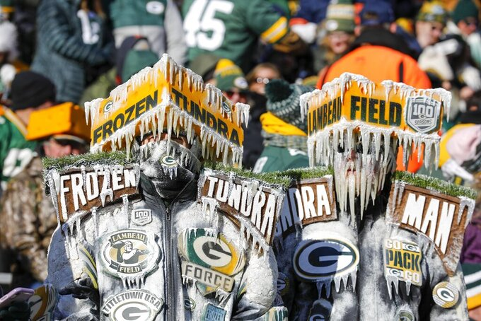 Fans at Lambeau Field watch during the first half of an NFL football game between the Green Bay Packers and the Chicago Bears Sunday, Dec. 15, 2019, in Green Bay, Wis. (AP Photo/Mike Roemer)