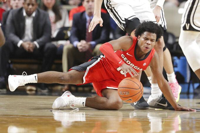 Georgia guard Sahvir Wheeler falls as he plays against Vanderbilt in the second half of an NCAA college basketball game Saturday, Feb. 22, 2020, in Nashville, Tenn. (AP Photo/Mark Humphrey)
