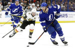 Tampa Bay Lightning center Brayden Point (21) carries the puck around Vegas Golden Knights right wing Reilly Smith (19) during the second period of an NHL hockey game Tuesday, Feb. 4, 2020, in Tampa, Fla. (AP Photo/Chris O'Meara)