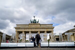 Climate activists of the Greenpeace organisation protest with big ice blocks reading 'Last Exit' in front of the Brandenburg Gate in Berlin, Tuesday, May 14, 2019. The protest is in reference to the Petersberg climate talks. (AP Photo/Markus Schreiber)
