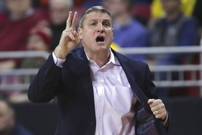 Boston College coach Jim Christian calls to his players during the first half of an NCAA college basketball game against Louisville in Boston, Wednesday, Jan. 29, 2020. (AP Photo/Charles Krupa)