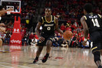 Bryant University guard Ikenna Ndugba (0) drives down the court during the first half of an NCAA college basketball game against Maryland, Sunday, Dec. 29, 2019, in College Park, Md. (AP Photo/Brien Aho)