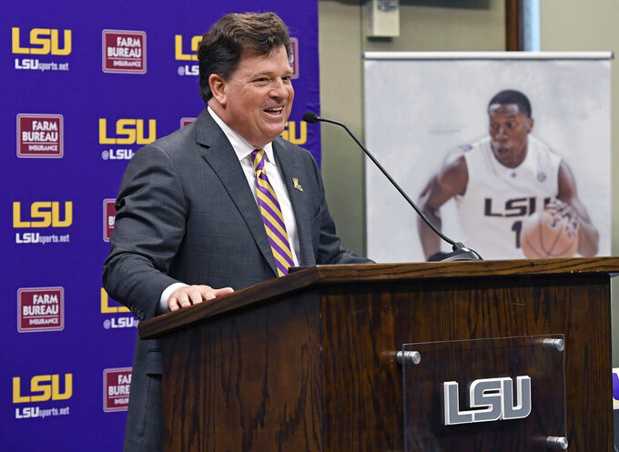 Scott Woodward answers questions after being introduced as the new Director of Athletics at LSU, Tuesday April 23, 2019, in Baton Rouge, La. Woodward, who graduated from LSU in 1985, was the Vice-Chancellor of External Affairs at his alma mater under former Chancellor Mark Emmert from 2000-2004. Woodward spent time at Washington and Texas A&M before accepting the job at LSU as a replacement for Joe Alleva. (Bill Feig/The Advocate via AP)