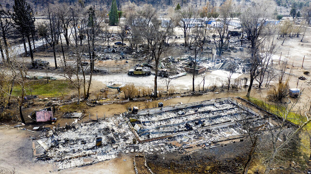 In this photo taken by a drone, homes destroyed by the Mountain View Fire are seen in the Walker community in Mono County, Calif., Wednesday, Nov. 18, 2020. (AP Photo/Noah Berger)