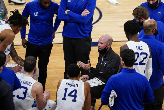Seton Hall coach Kevin Willard talks to the team during the second half of an NCAA college basketball game against Georgetown in the semifinals in the Big East men's tournament Friday, March 12, 2021, in New York. (AP Photo/Frank Franklin II)