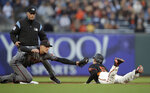 Arizona Diamondbacks' Nick Ahmed, front left, tags out San Francisco Giants' Mike Yastrzemski, right, in the first inning of a baseball game Saturday, June 29, 2019, in San Francisco. (AP Photo/Ben Margot)
