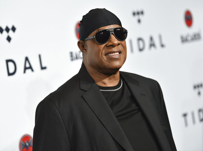 """FILE - In this Oct. 17, 2017, file photo, Stevie Wonder attends the TIDAL X: Brooklyn 3rd Annual Benefit Concert in New York.  Wonder on Tuesday, Feb. 9, 2021,  was awarded Israel's Wolf Prize, headlining a group of laureates in the arts and sciences receiving the prestigious recognition.  He was recognized for """"his tremendous contribution to music and society enriching the lives of entire generations of music lovers,"""" according to a statement from President Reuven Rivlin's office (Photo by Evan Agostini/Invision/AP, File)"""
