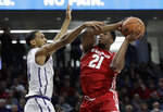 Wisconsin guard Khalil Iverson, right, drives to the basket against Northwestern guard Ryan Taylor during the first half of an NCAA college basketball game Saturday, Feb. 23, 2019, in Evanston, Ill. (AP Photo/Nam Y. Huh)
