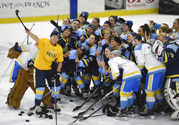 """FILE - In this Jan. 24, 2016, file photo, National Women's Hockey League All-Star players take time for a """"selfie"""" before the start of an all-star game at Harborcenter in Buffalo, N.Y. A person with direct knowledge of the plans tells The Associated Press the U.S.-based National Women's Hockey League is in the process of establishing an expansion franchise in the Toronto area, Tuesday, April 14, 2020. (AP Photo/Gary Wiepert, File)"""