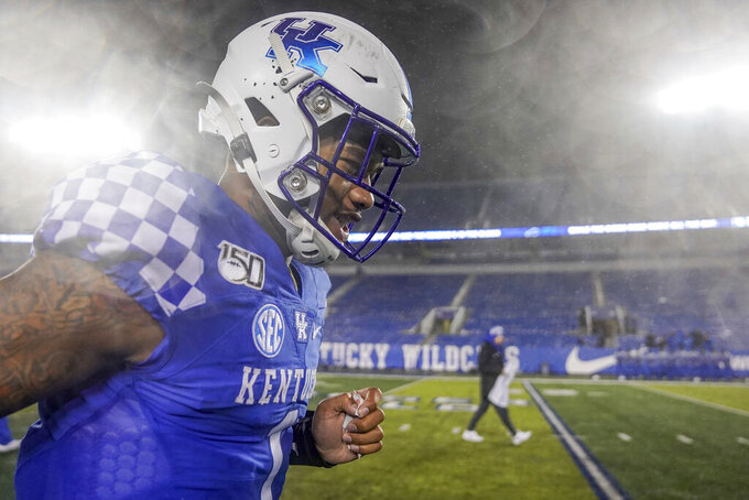 Kentucky quarterback Lynn Bowden Jr. (1) runs off the field after the NCAA college football game against UT Martin, Saturday, Nov. 23, 2019, in Lexington, Ky. (AP Photo/Bryan Woolston)