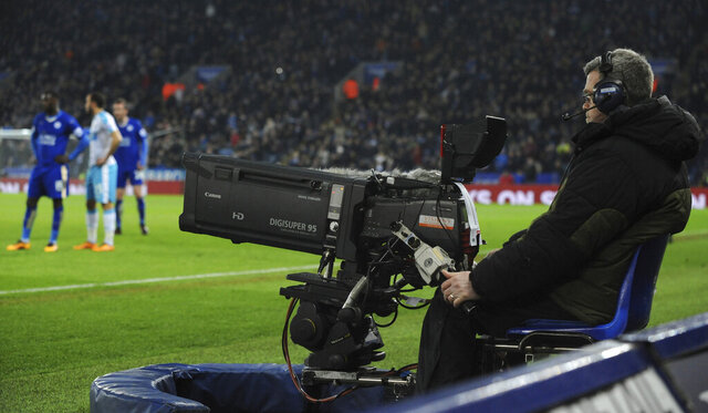 FILE - In this Monday, March 14, 2016 file photo, a view of TV camera during the English Premier League soccer match between Leicester City and Newcastle United at the King Power Stadium in Leicester, England. Television viewers in the Premier League's home market will get to watch a full round of games live for the first time in the first week of December, 2019. Amazon Prime bought the rights for all 10 matches this midweek and another round after Christmas as part of a three-year deal for British subscribers. (AP Photo/Rui Vieira, File)