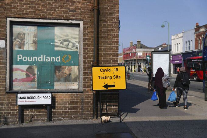 A view of sign directing people to a walk-in coronavirus testing centre on Marlborough Road in Southampton, England, Wednesday, Sept. 16, 2020. The British government plans to ration coronavirus testing, giving priority to health workers and care home staff after widespread reports that people throughout the country were unable to schedule tests. Prime Minister Boris Johnson on Wednesday will face questions about his handling of the COVID-19 pandemic in the House of Commons and before a key committee amid the outcry over the shortage of testing. (Andrew Matthews/PA via AP)