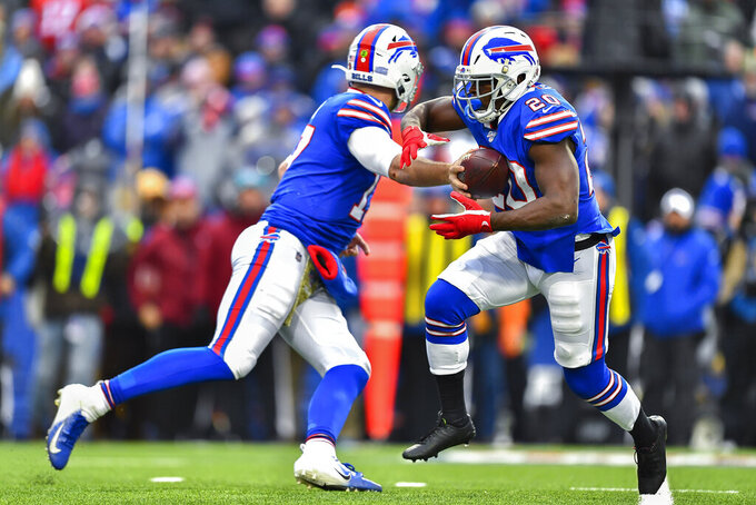 Buffalo Bills quarterback Josh Allen (17) hands off the ball to running back Frank Gore (20) during the third quarter of an NFL football game against the Denver Broncos, Sunday, Nov. 24, 2019, in Orchard Park, N.Y. (AP Photo/Adrian Kraus)