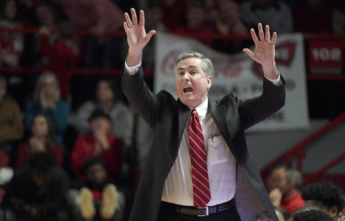 Western Kentucky head coach Rick Stansbury yells directions to his team during the second half of an NCAA college basketball game against Wisconsin, Saturday, Dec. 29, 2018, in Bowling Green, Ky. (AP Photo/Tim Broekema)