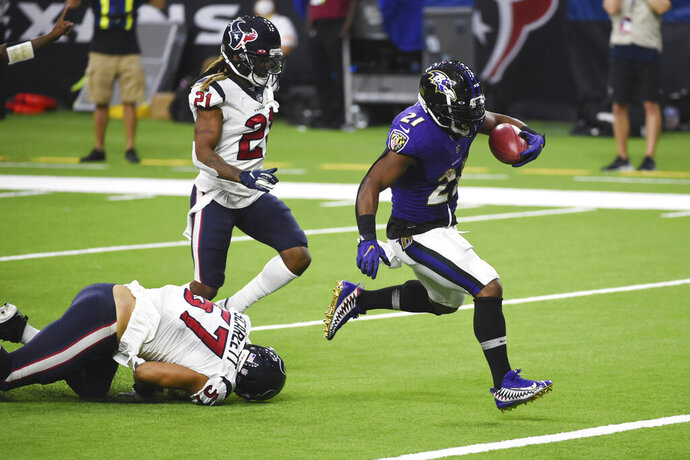Baltimore Ravens running back Mark Ingram (21) runs for a touchdown against the Houston Texans during the second half of an NFL football game Sunday, Sept. 20, 2020, in Houston. (AP Photo/Eric Christian Smith)