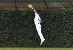 Chicago Cubs left fielder Kris Bryant makes a catch on a ball hit by San Diego Padres' Franmil Reyes during the seventh inning of a baseball game Friday, July 19, 2019, in Chicago. (AP Photo/David Banks)
