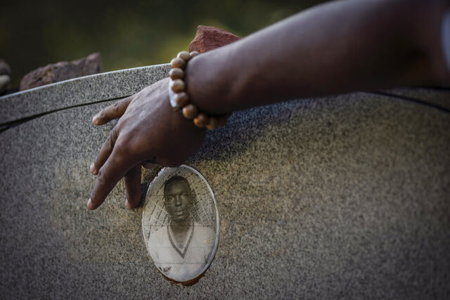 A portrait of James Chaney is seen on the headstone of his grave in Meridian, Miss., Saturday, Oct. 3, 2020. Chaney was one of three civil rights activists that was kidnapped by a deputy sheriff and local Klansmen, and driven to a narrow country road and shot at close range. Their bodies, buried in an earthen dam, were found 44 days later. (AP Photo/Wong Maye-E)