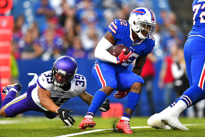 Buffalo Bills running back Marcus Murphy (22) gets past Minnesota Vikings safety Marcus Epps (39) during the first half of an NFL preseason football game in Orchard Park, N.Y., Thursday, Aug. 29, 2019. (AP Photo/Adrian Kraus)