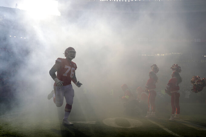 Kansas City Chiefs' Laurent Duvernay-Tardif (76) is introduced before the NFL AFC Championship football game against the Kansas City Chiefs Sunday, Jan. 19, 2020, in Kansas City, MO. (AP Photo/Jeff Roberson)