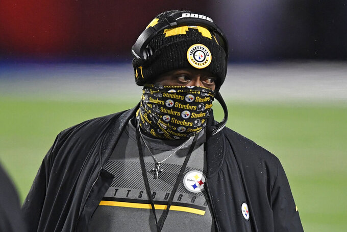 Pittsburgh Steelers head coach Mike Tomlin walks on the sideline during the first half of an NFL football game against the Buffalo Bills in Orchard Park, N.Y., Sunday, Dec. 13, 2020. (AP Photo/Adrian Kraus)
