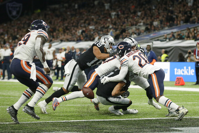 Oakland Raiders wide receiver Trevor Davis (11) fumbles as he is tackled during the second half of an NFL football game against the Chicago Bears at Tottenham Hotspur Stadium, Sunday, Oct. 6, 2019, in London. (AP Photo/Tim Ireland)
