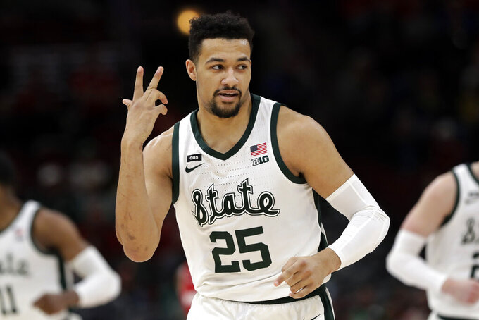 Michigan State's Kenny Goins (25) reacts after shooting a 3-point basket during the first half of an NCAA college basketball game against Wisconsin in the semifinals of the Big Ten Conference tournament, Saturday, March 16, 2019, in Chicago. (AP Photo/Nam Y. Huh)
