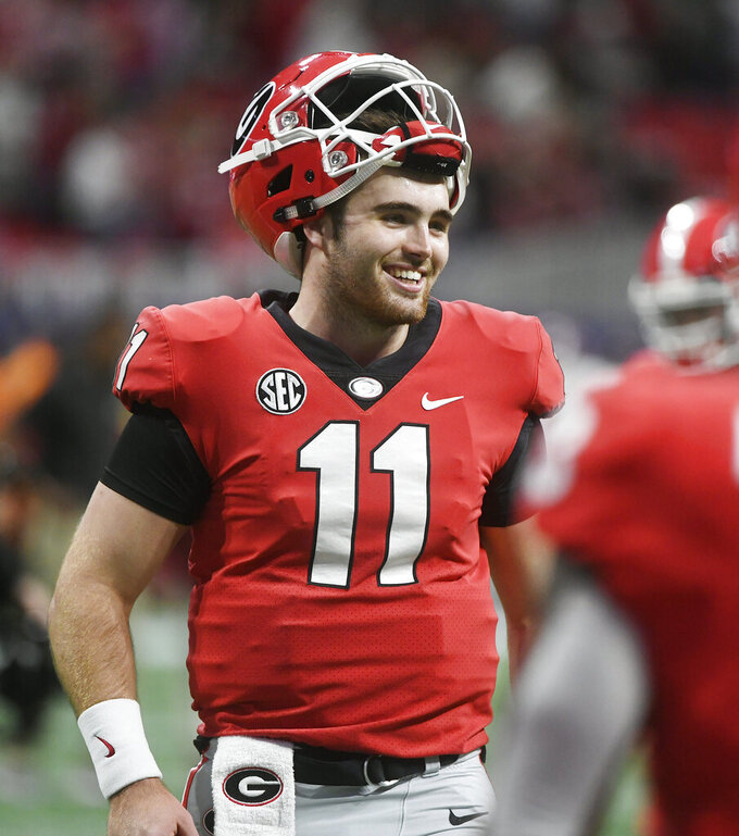 FILE - In this Dec. 1, 2018, file photo, Georgia quarterback Jake Fromm warms up before the Southeastern Conference championship NCAA college football game against Alabama in Atlanta. This year, a group of talented and experienced quarterbacks could help the SEC produce a little more drama. Georgia's Fromm, LSU's Joe Burrow, Florida's Feleipe Franks and Texas A&M's Kellen Mond are among the biggest reasons all those teams feel they have a realistic chance of knocking Alabama off its title perch. (AP Photo/John Amis, File)