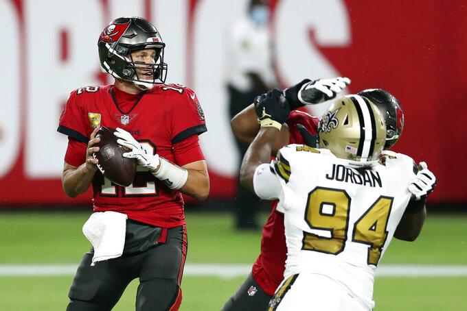 Tampa Bay Buccaneers quarterback Tom Brady (12) looks to pass against the New Orleans Saints during the first half of an NFL football game Sunday, Nov. 8, 2020, in Tampa, Fla. (AP Photo/Mark LoMoglio)