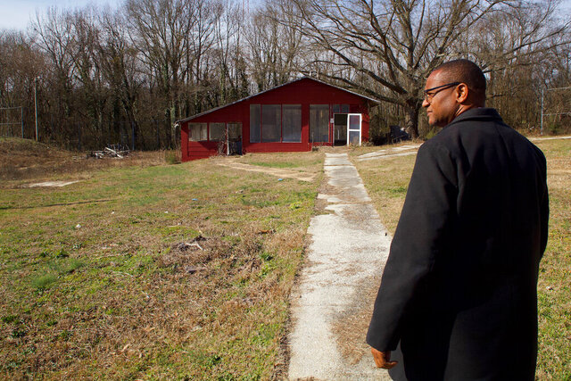 In this Wednesday, Jan. 22, 2020 photo, Kevin Muhammad, director of the Community Haven, walks around the former work release center in the Bushtown neighborhood in Chattanooga, Ten. Muhammad plans to convert the former jail into a community center. (Wyatt Massey/Chattanooga Times Free Press via AP)