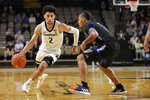 Vanderbilt guard Scotty Pippen Jr. (2) drives against Tulsa guard Darien Jackson during the first half of an NCAA college basketball game Saturday, Nov. 30, 2019, in Nashville, Tenn. (AP Photo/Mark Humphrey)
