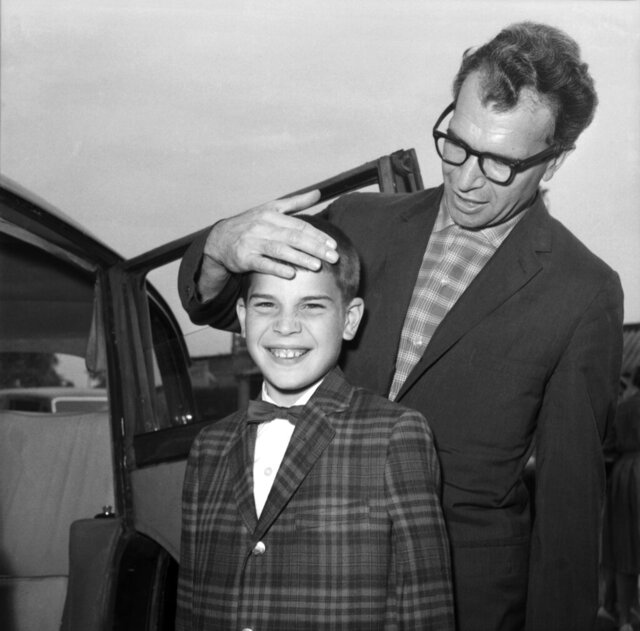 FILE - In this July 2, 1961, file photo, Dave Brubeck, the American Jazz musician, and his 13-year-old son Christopher, also a musician, arrive at London Airport, United Kingdom, from New York. Nearly eight years after his death, the final solo recording of late American jazz legend Dave Brubeck is set for release Nov. 6, 2020. Verve Records announced that