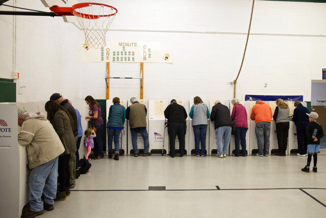 FILE - In this Nov. 6, 2018, file photo, voters cast their ballots at Collister Elementary in Boise, Idaho. On Tuesday, May 19, 2020, Idaho is holding an entirely mail-in primary for the first time as the state works to slow the spread of the coronavirus pandemic. (AP Photo/Otto Kitsinger, File)
