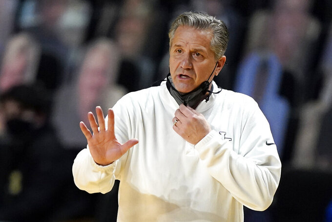 FILE - In this Feb. 17, 2021, file photo, Kentucky head coach John Calipari gestures during the first half of an NCAA college basketball game against Vanderbilt in Nashville, Tenn. Calipari said he contracted COVID-19 before July's NBA draft after being vaccinated but is relieved that the shot did its job in leaving him with mild symptoms. (AP Photo/Mark Humphrey, File)