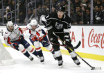 Los Angeles Kings' Dion Phaneuf (3) controls the puck in front of Washington Capitals' Jakub Vrana (13) during the first period of an NHL hockey game Monday, Feb. 18, 2019, in Los Angeles. (AP Photo/Marcio Jose Sanchez)