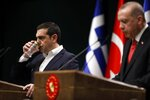 Greece's Prime Minister Alexis Tsipras drinks water during a press conference with Turkey's President Recep Tayyip Erdogan at the Presidential Palace in Ankara, Tuesday, Feb. 5, 2019. Tsipras and Erdogan are set to discuss an array of subjects that have strained relations between the two NATO allies, including territorial disputes in the Aegean Sea and gas exploration in the eastern Mediterranean. (AP Photo/Burhan Ozbilici)