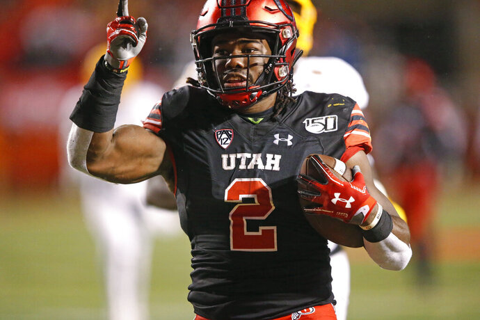 Utah running back Zack Moss scores on a 32-yard run against Arizona State during the second half of an NCAA college football game Saturday, Oct. 19, 2019, in Salt Lake City. (AP Photo/Rick Bowmer)