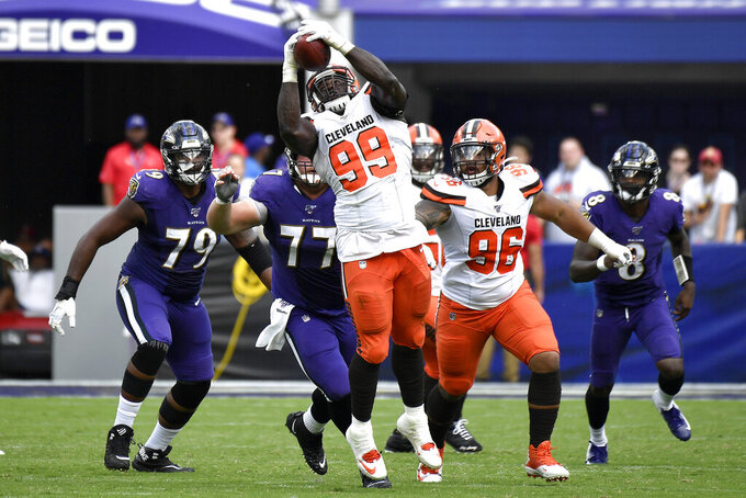Cleveland Browns defensive tackle Devaroe Lawrence (99) intercepts a pass from Baltimore Ravens quarterback Lamar Jackson (8) during the second half of an NFL football game Sunday, Sept. 29, 2019, in Baltimore. (AP Photo/Brien Aho)